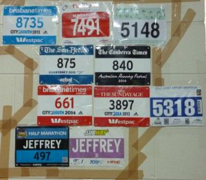 The bib wall of fame at home, with the newest addition (number 5318) alongside the pair of red and white bibs.