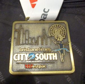 The City2South medal, a part of the Run Out Loud series that sponsors are looking to promote as opposed to individual events. Some believe the City2Surf medal should also look like this.